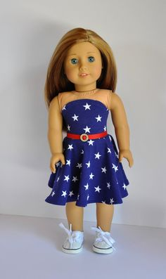 Navy blue with white star print bandeau dress by Unendingtreasures on Etsy. Made using the Easy As Pi Bandeau Dress pattern. Get it at http://www.pixiefaire.com/products/easy-as-bandeau-dress-18-doll-clothes. #pixiefaire #easyaspibandeaudress