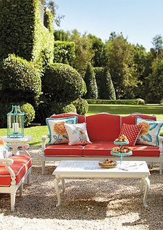 Nothing screams Spring like white iron furniture with bright coral cushions and light turquoise accents. Such an inviting outdoor space! #springhassprung
