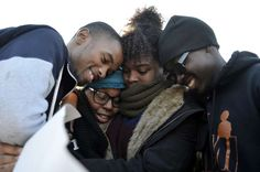 Members of Concerned Student 1950 embrace after the announcement that University of Missouri System President Tim Wolfe would resign Monday, Nov. 9, 2015, in Columbia, Mo.