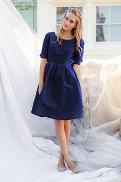 Shop for vintage style fit and flare knee length dresses with 3/4 bow sleeves and boatneck & other classic modest clothing for women online at Shabby Apple!