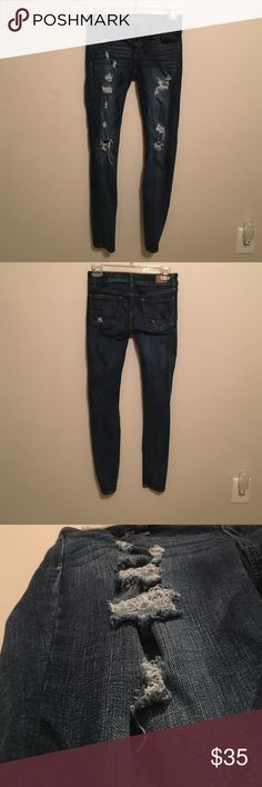 American Eagle ripped dark blue jeans Only worn a few times In great condition. True to size and fitting to ankle. American Eagle Outfitters Pants Skinny