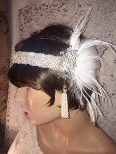 Great Gatsby inspired headpiece headband flapper 1920s style ivory antique silver ox wedding headpiece wedding headband hair accessories bridal headband ivory & white feather headpiece headband fascinator  ORIGINAL DESIGNS BY ARLENES RUBIES ALL RIGHTS RESERVED.  Rhinestone headband with silver tone rhinestone adornment, dangling pearls in silver, with white feathers. You can choose if you want the feathers to be facing up or back at checkout, please see the pictures in the listing for a…