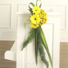 This site has a lot of ideas for decorating the church plus free flower tutorials.