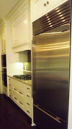 Plaza-condo-remodel-kitchen-fridge-wall-mount-professional-stove