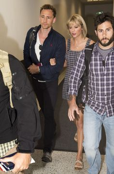 Taylor Swift Accompanies Tom Hiddleston to Australia for 'Thor Filming: Photo Taylor Swift links arms with her boyfriend Tom Hiddleston while landing at the airport on Friday (July in Sydney, Australia. The singer has accompanied… Taylor Swift Style, Taylor Alison Swift, Tom Taylor, Taylor And Tom Hiddleston, Calvin Harris, Taylor Swift Pictures, Taylors, Celebs, Celebrities