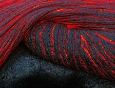 LAVA THAT IS MOVING appears as a beautiful array of black and red swirling liquid. Once lava reaches the air, it can form into a variety of shapes and colors. The color it turns depends on the temperature and composition in the rock.  Filmmaker, Sam Cossman and his team headed to the Pacific Islands of Vanuatu to gain a better understanding of how microbial life exists in extreme heat conditions. The images helped science and provided a stunning up-close view of lava in action.