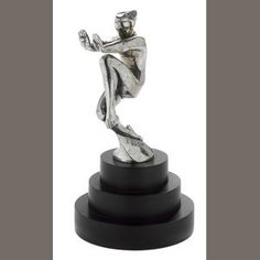 An 'En Avant' mascot, by Frederick Bazin, French, 1920s,  stamped 'F Bazin' to left side of base, nickel-plated mascot depicting an Art Deco stylized male nude pushing with his hands outstretched, on a custom Art Deco base, 5½ in. high