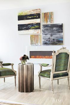 The homeowner spotted the hand-carved antique French armchairs, already upholstered in Opuzen's blue-and-green flocked velvet, in Buckingham's Chicago showroom. The designer juxtaposed them with modern abstracts by Lynn Basa. Barney was responsible for the glass-framed electric Simplifire wall-mounted fireplace, which features flames that change color.