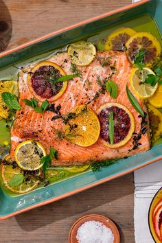 NYT Cooking: This is truly the best way to cook salmon. Slowly roasting an already fatty fish in an even more luxurious fat (here, olive oil) makes it nearly impossible to overcook. Plus, you can flavor that oil with whatever you fancy — spices, herbs, ci Salmon Recipes, Fish Recipes, Seafood Recipes, Dinner Recipes, Cooking Recipes, Healthy Recipes, Recipies, Tilapia, Olives