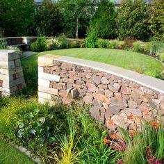 Serpentine garden curving wall, designed by carolyn grohmann Bog Garden, Water Garden, Garden Beds, Garden Walls, Landscape Walls, Landscape Architecture, Back Gardens, Outdoor Gardens, Child Friendly Garden