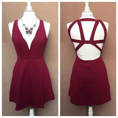 Cage back plunge dress available in stores! Available in black and wine. #shoppitaya