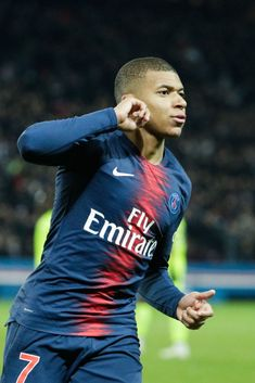 3c99485c76bf Paris Saint-Germain s French forward Kylian Mbappe celebrates after scoring  a goal during the French