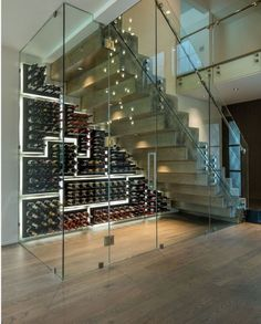 Under Stair wine room with custom glass featuring the PEG System wine racking on glossy black finish backings. The cut out panels form a mosaic pattern with halo lighting for added dramatic effect. Wine Cellar Modern, Glass Wine Cellar, Home Wine Cellars, Wine Cellar Design, Under Stairs Wine Cellar, Wine Cellar Basement, Cave A Vin Design, Casa Magna, Wine Shelves