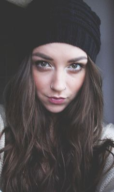 black beanie and silver nose ring