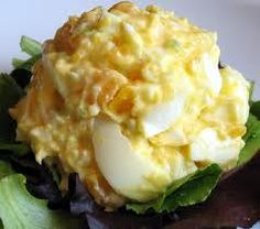 Healthy Egg Salad  9 hardboiled eggs (chopped)  1/2 cup Plain Greek Yogurt  1/2 of squeezed lemon  2 stalks of celery (minced)  2 Tbsp of Dijon Mustard  1/2 tsp garlic powder  1/4 cup of green onions  salt/pepper to taste  Mix all ingredients together.  Serve on lettuce leaves, whole grain bread or cracker