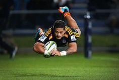 Augustine Pulu of the Chiefs dives over the whitewash