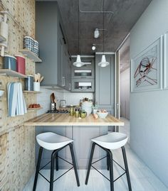 in this Super-Small Apartment kitchen notice the storage wall. Movable pegs allow shelves to be moved around to meet storage needs. Brilliant.