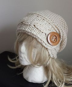 Here it is, my version of the crochet cabled headband slouchy hat with a great big button! I've been making this hat for over two years...