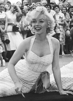 Marilyn Monroe(putting her name and footprints in the cement in front of the Grauman's Chinese Theater with Jane Russel) Gentlemen Prefer Blondes