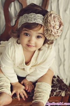 cuttest little girl! loving everything about this! lace headband, chunky flower, leg warmers and that face!
