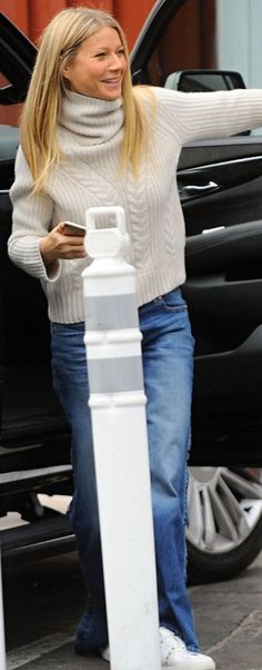 Who made  Gwyneth Paltrow's studded sneakers and white cable turtleneck sweater?