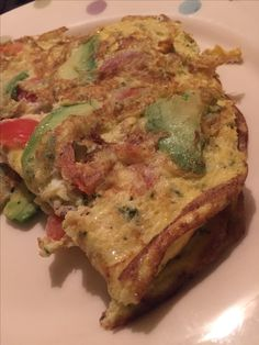 Avocado, cherry tomato and pesto omelette
