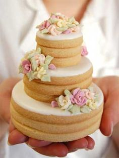 Stacked Wedding Cookie Cake; those would be really cute to have on the tables at the receptions!