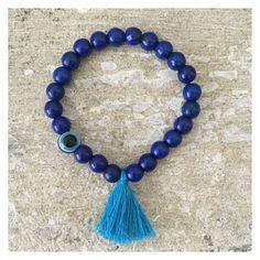 Blue evil eye bracelet with turquoise tassel by LindsayRaeDesigns