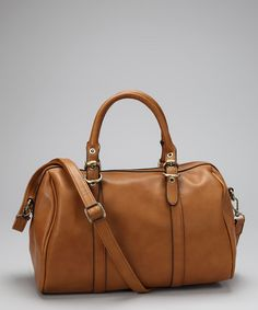 Featuring a sleek faux leather exterior and a roomy interior, this bag will inspire some glamorous getaways. A double set of straps customizes the carrying.13'' W x 9'' H x 6'' DPolyurethaneImported