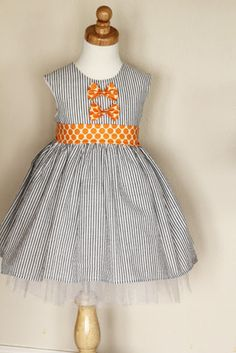 seersucker + orange polka dot dress with a hint of tulle {link to pattern by Girl.Inspired}