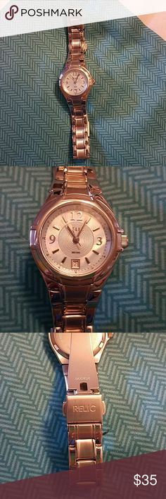 Brand New Relic Silver Watch Never worn, silver Relic watch.  Has window with date.  Face of watch is oppal/ iridescent. Relic Accessories Watches