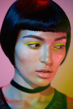 Tron-Inspired Beauty Photo Shoot | '80s glam + makeup inspiration + neon eyeliner | [ https://style.disney.com/beauty/2016/07/09/this-tron-inspired-beauty-shoot-is-gorgeous/ ]