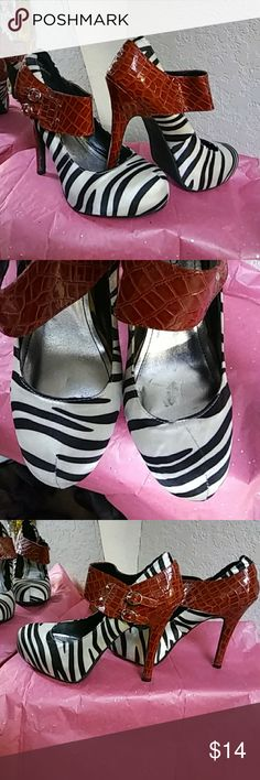 Shoes Zebra print satin fabric with red crock material with 2 small buckles on sides. Little scuff line on right shoe as shown in pic 2. Only wore once. BAMBOO Shoes Heels