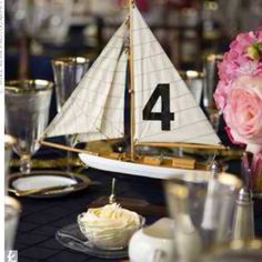 Sailboat centerpiece (or race car, train, plane, horse, etc.) Whatever your guy likes.