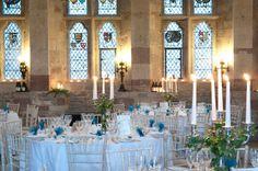Candlelit wedding reception at Berkeley Castle wedding venue in Gloucestershire|