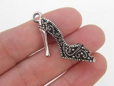 Hey, I found this really awesome Etsy listing at https://www.etsy.com/listing/159140827/bulk-10-high-heel-shoe-pendants-antique