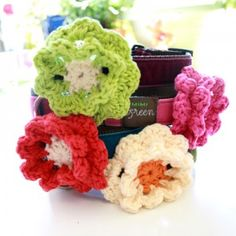 Hand-crocheted, made in the U.S.A., dog collar flower accessories by Mimi Green.  Attach to any collar or lead!
