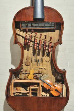This violin makers shop by W. Foster Tracy, is a miniature built inside a full-size violin. It was on display at the Mini Time Machine Museum of Miniatures, Tucson, Arizona. All completed instruments and tools are fully functional in this model. Violin Shop, Violin Makers, Violin Art, Tiny Violin, Violin Painting, Violin Music, Guitar Shop, Full Size Violin, Maker Shop