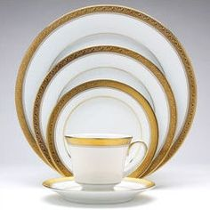 Features:  -White porcelain with gold banding.  -Dishwasher safe.  -Part of the Legendary collection.  -Service For: 4.  -Set Includes: (4) Dinner Plates; (4) Salad Plates; (4) Bread & Butter Plates;