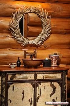 Resting atop the vanity is a copper sink and faucet assembly. Crowning the entire ensemble is a beautiful oval mirror crafted from interior design home design room design house design house design Home Decor Bedroom, Mirror Crafts, Cabin Decor, Log Cabin Homes, Home Decor, Timber House, Rustic Bathrooms, Antlers Decor, Rustic House