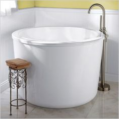 A Japanese soaking tub stands apart from traditional shapes. It's elegant and functional. (Signature Hardware, $2,997)