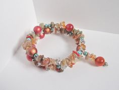 This memory wire bracelet boasts colors of a warm summer day.
