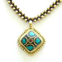 Gold and turquoise didi locket necklace made by HIV/AIDs infected and affected women in New Delhi, India. $24.00