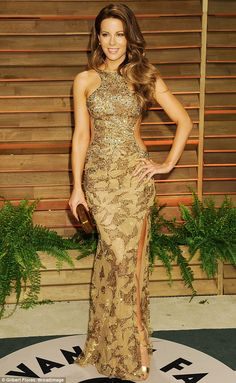 Shimmering star: The Total Recall actress looked incredible in her golden gown