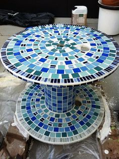 Mosaic Garden Furniture - Could use large industrial spools, cover in concrete, & mosaic!