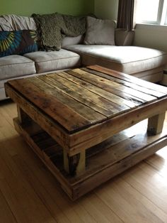 I love this finish. I don't know that I would make it this tall though. Coffee Table made from paint pallets