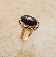 Vintag Ring - Vintage Black Onyx and Diamond Ring by TheCopperCanary on Etsy https://www.etsy.com/listing/108206516/vintag-ring-vintage-black-onyx-and