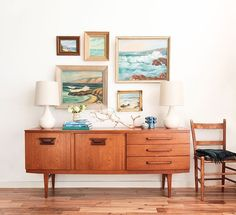 Emily Henderson highlights her coastal inspired paintings with this lovely mid-century credenza