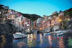 Riomaggiore, Italy (Cinque Terre): The village, dating from the early thirteenth century, is known for its historic character and its wine, produced by the town's vineyards. Riomaggiore is in the Riviera di Levante region and has shoreline on the Mediterranean's Gulf of Genoa, with a small beach and a wharf framed by tower houses. Riomaggiore's main street is Via Colombo, where numerous restaurants, bars and shops can be found.