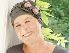 This classic turban comes in mushroom or blue with a stylish floral detail to lift any outfit ...
